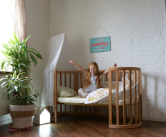 ребенк в ліжечку